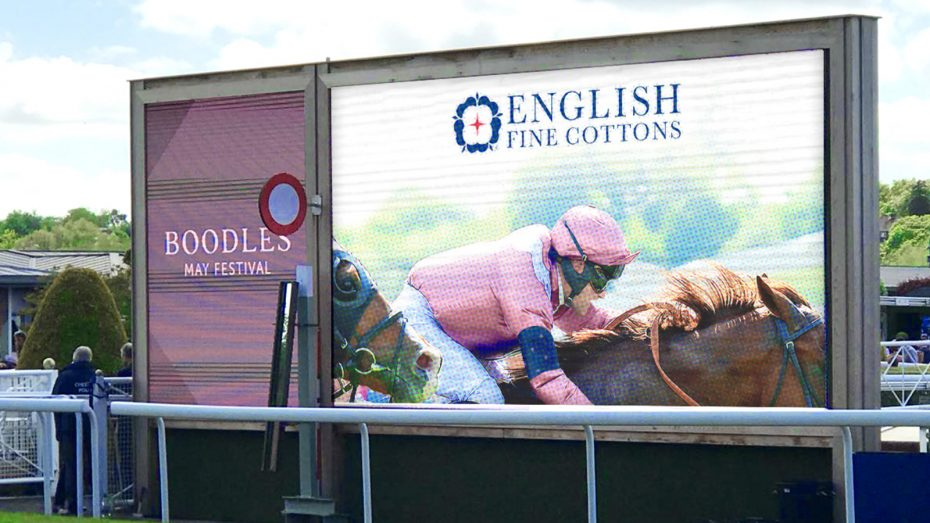 the big screen at chester races featuring the english fine cottons advert